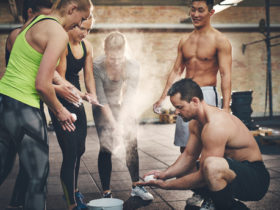group of athletic people getting ready for work out