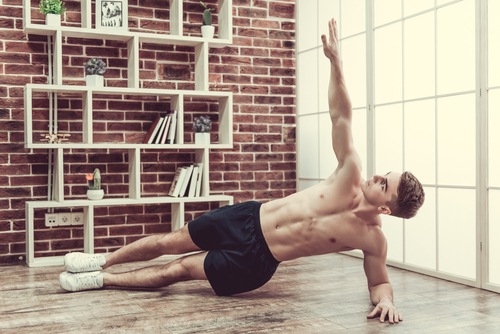 fit man who takes Progentra doing side planks