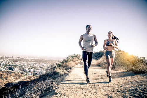 fit couple running outdoors