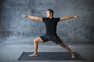 man doing yoga pose, stretch, improve ejaculation