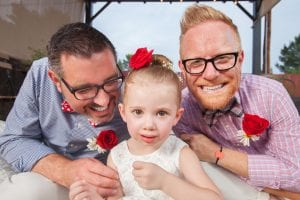 gay men couple with daughter, happy family