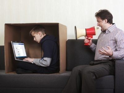 dad yelling at son in laptop with a megaphone