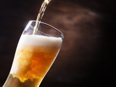 cold beer poured to glass