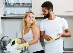 couple doing dishes together, man helping with chores