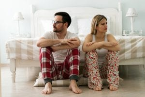 couple in bedroom having issues, not talking to each other