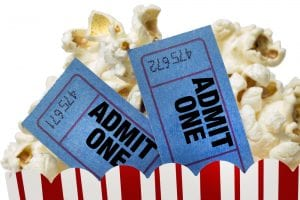 movie tickets and popcorn for a date