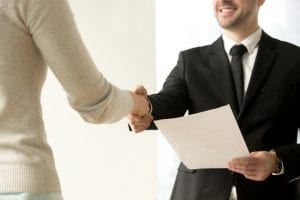 man shaking hands with colleague