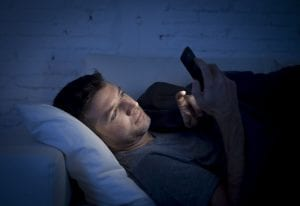 man in the middle of the night on his mobile phone
