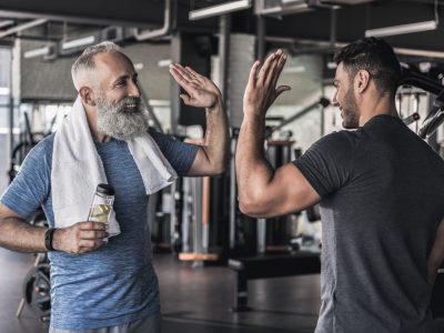 healthy men giving a high five