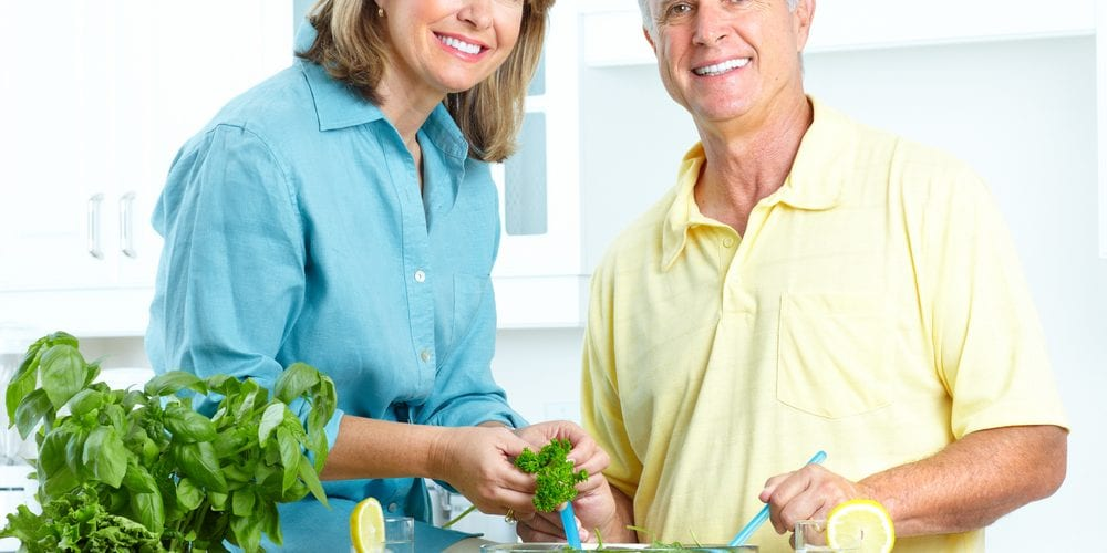 elder couple preparing healthy food