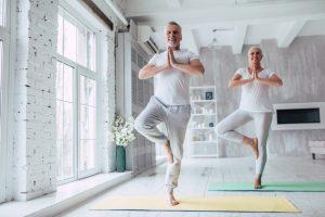 elderly couple doing yoga