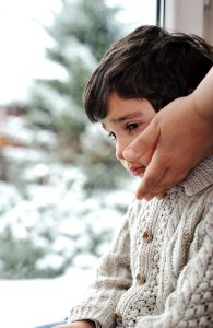 young boy feeling sad during winter